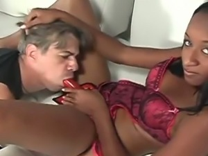 Dominatrix ebony punishing her male slave