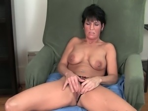 Busty momma in solo cunt playing