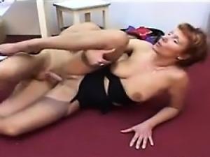 Mature Woman Giving A Footjob