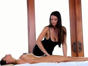 Busty masseuse rubs box with stone