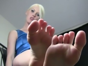 Blonde in sexy shiny heels poses for footboys