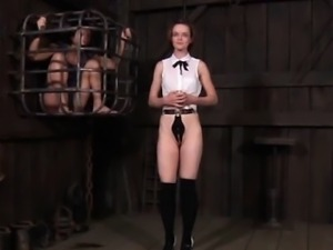 BDSM bonded submissives visiting their cage