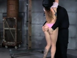 Restrained submissive silenced by male dom