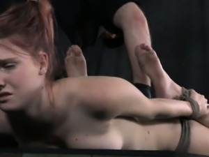 Hogtied submissive being caned by powerful maledom