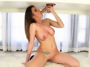 Cocksucking brunette feeding on hard cock