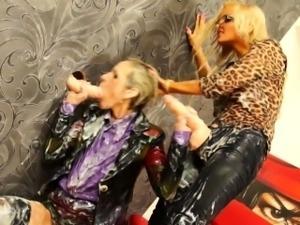 Strapon loving lesbos at gloryhole