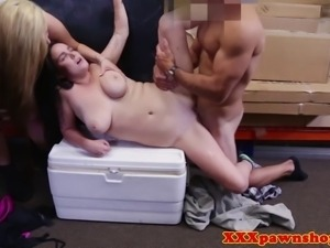 Pawnshop voyeurs fuck the same cock