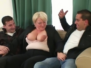 Granny gets wasted and creamed by two studs.