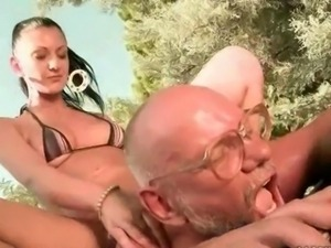 Sexy young brunette fucking a grandpa outdoor