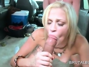 Topless blonde gives double BJ in sex bus