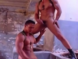 Hardcore sex of military buddies on ruined building.