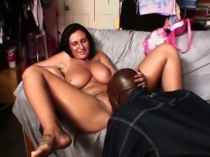 Busty brunette gets a mouthful of black cock