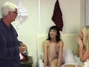 Two CFNM British girls giving handjob to naked older guy