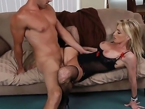 Slender blond-haired MILF Nadia Hilton is incredibly sexy in her black...