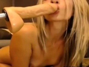 Cute blonde is anal fucked by fuck machine