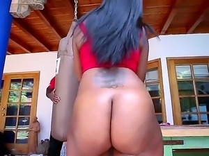 Juicy dark skinned girl with killer big booty bends over and pulls off her...