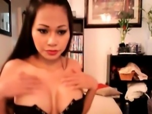 Asian in sexy leather dress suck a dildo