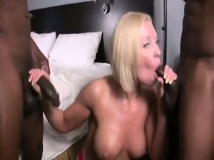 Horny wife eating two black cocks