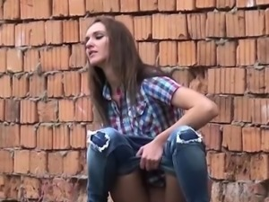 Smoking hot brunette pissing nearby a bridge