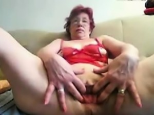 55 years old April dildoing on home webcam