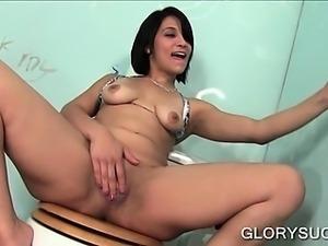Slutty brunette rubbing cock on gloryhole