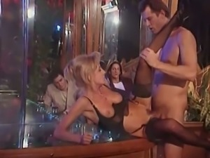 Blonde stripper gets fucked on the bar table.
