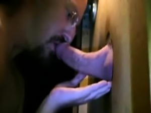 Mature bears sucking cocks through a gloryhole