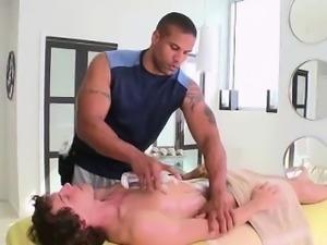 Gay hunk giving massage to straight guy at spa