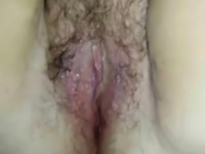 Licking and fingering a hairy pussy