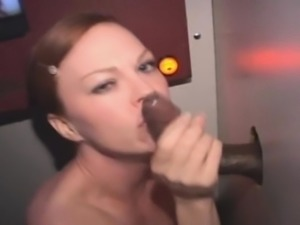 Redheaded Amateur Taking Facial Through A Glory Hole