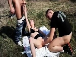 Petite teen fisted outdoors by two brutes