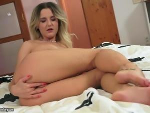 Playful solo girl Eva Kerstin with natural boobs pulls down her black panties...