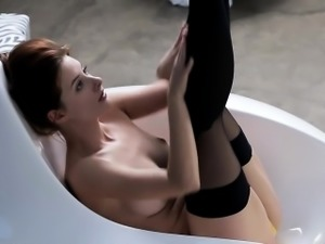 A redhead beauty Anna Tatu in black stockings exposes her