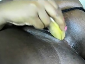 Black Babe Stuffs her Pussy with Objects