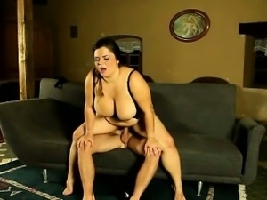 Domme Leny rubs her large tits and presses her fat ass into