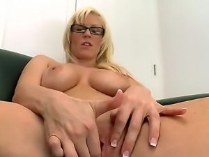 Here, we have a blonde young milf that spread her legs on the couch! Shes...