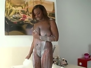 Naked ebony chick Tori Taylor plays with her huge black tits  and then gives...