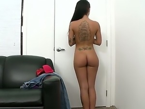 Tattooed totally naked brunette Christy Mack exposes her juicy boobs before...