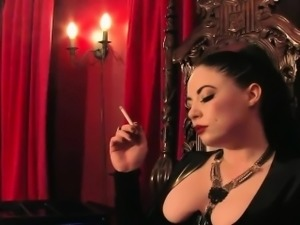Dominant mistress smoking and using heels