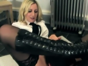 Uniformed femdoms smother submissive