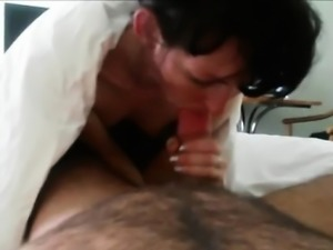 Mature brunette sucks and fucks a hairy shaft