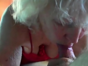 Cocksucking granny devouring a young shaft