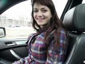 Brunette Aimee gets undressed in the car
