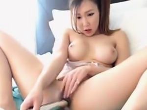 Asian Cutie Masturbating With Some Toys