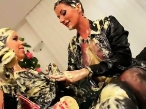 Hotties enjoy pouring moist cream on their clothed bodies