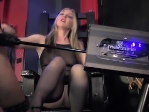 Milf femdom watching a sub fucking a machine