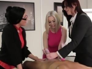 Clothed mistress tugs rod