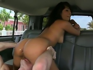 Slutty girl is shaking her ass and exposing her small natural tits on the...