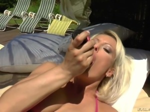 Blonde MILF Vanessa Moore in pink bikini enjoys pussy fingering right in the...