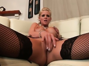 Phoenix Marie with big knockers and hairless pussy strips down to her bare...